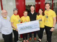 Corinne Evans (third from left) presents a cheque to the organisers of the Darkness Into Light Tralee event. From left; Martin Brosnan, Anne Leahy O'Shea, Con O'Connor of Pieta House, Georgina Collins of Corinne Evans Physiotherapy and Chris Horan of Corinne Evans Physiotherapy. Photo by Dermot Crean