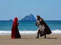 Forces of Nature…Andrea Paolucci, as Jedi and Giorgia Gallerani,Royal Guard, at St.Finan's Bay, The Glen, Ballinskelligs County Kerry, with Skellig Michael and Skellig Beag in the distance, where 'Star Wars'  the Force Awakens was filmed. The Characters are part of  Fáilte Ireland's 'May the 4th be with you' Festival this weekend, in Kerry, and Donegal to commemorate the 4th of May, when fans across the globe celebrate Star Wars.Photo:Valerie O'Sullivan/FREE PIC*** /issued 05/05/2019