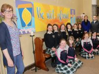 Presentation Secondary Art teacher Lily O'Sullivan (left) with Transition Year students, TY co-ordinator Anne O'Mahony and Fr Sean Jones in front of the mural at the Church of the Immaculate Conception on Wednesday. Photo by Dermot Crean