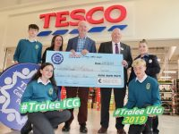 Chairman of Tralee ICG, Mike Culloty accepts a cheque from Tesco Manor West. Included is, student Bobby Byrne, Deputy Manager Tesco Manor West Elaine McHugh, Personnel Manager Anthony Hornibrook, Mike Culloty and Tesco Store Champion, Louise O'Connor. Kneeling; Donna Rogers and Odhan Ferris. Photo by Dermot Crean
