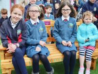 Erin O'Sullivan (second left) with friend Rebecca O'Brien, sister Megan O'Sullivan and Róisín O'Callaghan on the new 'Buddy Bench' made by the Vale Of Avoca Men's Shed group. Photo by Dermot Crean