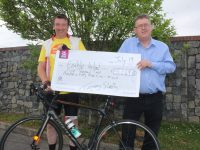 Tommy Sheehy hands over the latest cheque for €5,249 to Sean Scally of Enable Ireland Kerry Services. Photo by Dermot Crean