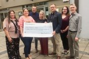 Representative of Down Syndrome Kerry accept a cheque from Tralee Chamber Alliance on Monday.