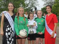 Roses with representatives from soccer clubs launching the Rose Bowl competition. Photo by Dermot Crean