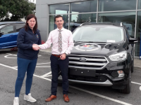 Tricia Kelly of Kerry Cancer Support Group accepts the keys of a 192 Ford Kuga from Kieran Griffin of Kerry Motor Works.