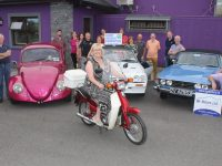 Trish Horan on a Honda 50 joined by members of the Kingdom Veteran Vintage & Classic Car Club looking forward to the 10th Ballymac Vintage Run later this month. Photo by Dermot Crean