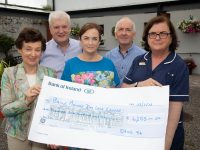 Renee Fitzgibbon and Trish White present a cheque to Paddy Garvey, Aidan Kelly and Rose Daly of Baile Mhuire Day Care Centre. Photo: Joe Hanley