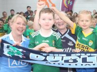 Dublin fans Catherine Buckley and Nuala Murphy with young Kerry supporters at jersey day at Caherleaheen NS. Photo by Dermot Crean