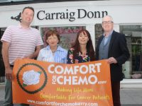 Mikey Sheehy and Mary Fitzgerald of Comfort For Chemo Kerry with Carraig Donn store manager Catherine O'Sullivan and stylist Danny Leane looking forward to the fundraiser on Friday, August 16. Photo by Dermot Crean
