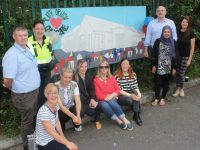 Residents with Garda Cathy Murphy, artist Muiríosa Murphy at one of the murals at Rath Óraigh. Photo by Dermot Crean