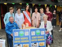 Rose fo Tralee Sinead Flanagan launches the annual Kerry Hospice coffee morning with, seated, Joe Hennebery and Mairead Fernane. At back; Bridie O'Connor, Catherine O'Halloran, Mary Shanahan, Ita Behan and Fiona Kirby. Photo by Dermot Crean
