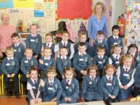 Teacher Aileen Griffin (back right) and Peggy Sweeney with Junior Infants at Scoil Eoin on their first day at school. Photo by Dermot Crean