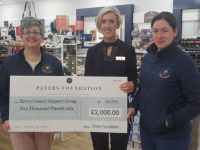 Norma Burke (centre), Assistant Manager of Pavers in the Outlet Centre in Killarney, presents a cheque to Breda Dyland and Trish Kelly of Kerry Cancer Support Group.