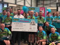 Woodies Tralee Store Manager, Tadhg O'Regan, presenting the cheque for €7,055 to Declan Ronayne CEO Woodie's and Heroes Cyclists on Monday last.