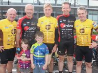 Phil McCarthy, Thomas McCarthy, Sean Kelly, Aidan Cronin and Tom Fitzgerald with, in front, Lelia and John McCarthy at the Tour de Munster Stage end in Tralee on Friday. Photo by Dermot Crean