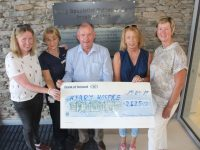 Andrea O'Donoghue (left) presents a cheque for €2,425 to the Kerry Hospice. Also included is Aine Moriarty, Joe Hennebery, Joan Carmody and Maura Sullivan. Photo by Dermot Crean