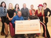Joe Hennebery accepts a cheque of €12,815 from Niamh O'Carroll (seated) and some Karen Condon, Conor Cusack, Caroline Corkery, Sharon Condon and Andrea Thornton of the Great Irish Marathon runners, back from left; Felicity Sheehy, Patrice O'Mahony,
