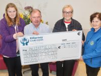 Brenda Galvin (left) and Carmel Galvin (third from left) present at cheque to Joe Hennebery and Mary Shanahan of the Kerry Hospice Foundation at the Palliative Care Unit on Thursday. Photo by Dermot Crean