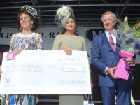 Mary Kelliher (centre) receives her prize for winning Best Dressed Lady at Listowel Races. Photo by Dermot Crean