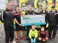 At the presentation of a cheque from St Brendans Park FC to Bumbleance were Colm O'Loughlin, Ed O'Regan, Jim Burke and Mary Heffernan of Bumbleance and Christy Leahy and, in front Sean McCannon and Shane Griffin. Photo by Dermot Crean
