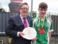 Paddy Allen of Na Piarsaigh presents Na Gaeil captain, Sean Barrett with the Abie Allen Plate. Photo by Adrienne McLoughlin