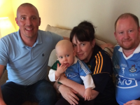 Kieran Donaghy with little Chloe Jenkins, her mom Fiona O'Connor and dad Gareth Jenkins at their home in Cork last week.