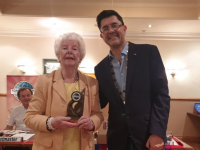 Celine Slattery receiving a special Lifetime Achievement Award recently, from Antony Garvey of Tralee Toastmasters.