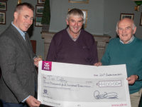 Tim Coffey who was the winner of €4,400 in the Na Gael GAA Club Lotto and presenting Tim with his cheque on Tuesday evening at the club house, Tim Lynch (Chairman) and Pat O'Connor (seller) Photo Joe Hanley