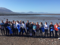 Gaelcholaiste Chiarrai students collecting waste at Cockleshell.