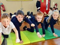 Students enjoying the Pilates workshop as part of the 'Health & Wellbeing' Day.