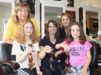 Seated; Meabh, Majella and Maria O'Connell with Kathleen Collins of Recovery Haven and Carrie Ann Clifford of Hairworks after the girls had their hair cut for charity on Wednesday. Photo by Dermot Crean