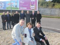 Launching the new Tralee App at the Manor West Retail Park roundabout were, in front; Ken Tobin, Tralee Chamber Alliance, Michele King of The Rose Hotel and TCA and Minister Brendan Griffin. At back; Declan Murphy of Fáilte Ireland, John Griffin of Kerry County Council, Siobhan Donnelly of Cara Credit Union, Darach O'Flaherty of Booniverse, David Scott of TCA, Pa Laide of Cara Credit Union, Derek Rusk of Cara Credit Union and Paul Ruane of TCA and Midpoint Creative. Photo by Dermot Crean