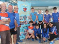 Kingdom Swimming Club coaches Mike O'Connell, Ger McDonnell and Tim O'Connell with Munster Squad members Rory Boyd, Jack Costello, Aisling O'Connell and Kim McTigue. Back from left; Joe Reidy, Grace Reidy, Evelyn Fox and Jack Doyle at Tralee Sports Complex on Wednesday. Photo by Dermot Crean