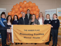 Students, Teachers, of Presentation Secondary School Tralee Con O'Connor (Pieta House) and David Moran(Kerry Footballer) who were invited to raise the Amber Flag in conjunction with Mental Health Week on Thursday. Photo Joe Hanley