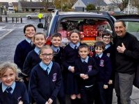 Ardfert NS Student Council helps Dan Murphy load the 200 Christmas shoeboxes donated by the children.