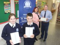 Pupils Grainne O'Donnell and Christian O'Sullivan Dunne with just two of the iPads presented to St Brendan's NS Blennerville, by Margaret Kissane of Connect Kerry, pictured at back with Principal Robbie O'Connell. Photo by Dermot Crean
