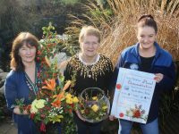 Kathleen Reidy (centre) launching her floral exhibition in aid of Recovery Haven, with Sharon Villa (left) and Marisa Reidy. Photo by Dermot Crean