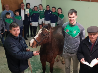 In front, Eamonn Browne with Jack Barry and Donal Lucey launch the Na Gaeil Race Night, joined at the back by club members. Photo: Joe Hanley