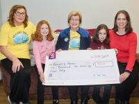 Majella O'Connell (right) with daughters Maria and Meath who presented a cheque for €1,750 to Kathleen Collins and Maureen O'Brien of Recovery Haven on Tuesday. Photo by Dermot Crean