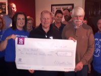 Con O'Connor of Pieta House accepts a cheque at McElligott's Bar on Saturday.
