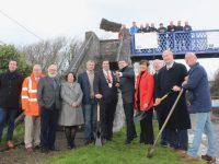 Minister Brendan Griffin turns the sod on the Tralee-Fenit Greenway at Fenit on Sunday with, from left; Cllr Mikey Sheehy, Charlie O'Sullivan KCC, Deputy Martin Ferris, CE of KCC Moira Morrell, Cllr Pa Daly Cathaoirleach KCC Cllr Niall Kelliher, Cllr Norma Foley, Mayor of Tralee Jim Finucane and Cllr Sam Locke. Photo by Dermot Crean