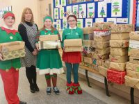 Collette Price of Tralee Soup Kitchen with Blennerville NS pupils and some of the 46 shoeboxes collected for people who use the Soup Kitchen. Photo by Dermot Crean