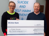 Caroline Houlihan presenting a cheque to Con O'Connor of Pieta House Tralee.