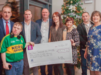 DC 30/11/2019 - REPRO FREE FREE PIC Pictured with cyclist Sean Kelly is the Kerry Branch at the Tour de Munster 2019 cheque presentation at Clayton Hotel Silver Springs in Cork on Saturday, November 30th. This yearÕs Tour de Munster charity cycle from August 8th Ð 11th raised Û316,254.86 for the Munster branches of Down Syndrome Ireland. Pic: Diane Cusack
