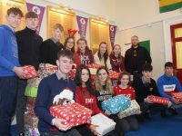 Gaelcholáiste Chiarraí students and Philip Lyons of Novas with some of the shoeboxes students collected for Arlington Lodge. Photo by Dermot Crean