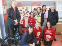 At the Lions Club Christmas party for the preschool at St Brigid's Community Centre in Hawley Park on Friday were in front; Rhona Johnston, Annette O'Sullivan and Mena Quiligan. At back; Sean Cooke, Santa, Mena Quilligan,  Photo by Dermot Crean