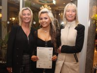 Nicola Casey with her Hairdressing certificate with Niamh Casey and Paula Casey at the Kerry College Monavalley Presentation of Certificates and Awards Night at The Rose Hotel on Thursday. Photo by Dermot Crean