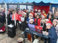 Listellick NS pupils singing carols in The Square on Friday. Photo by Dermot Crean