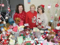 Betty Brosnan, Nora Burke and Emer McDaid at the John Mitchels Christmas Markets on Saturday. Photo by Dermot Crean