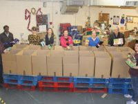 Volunteers filling St Vincent de Paul hampers at their warehouse in Monavalley on Friday. Included are Charlotte Dolan, Jaafar Alrusan, Courtney Sheehy, Rose O'Reilly, Catherine O'Connell, Helen Locke, Pat Hussey and Natalie O'Connell. Photo by Dermot Crean